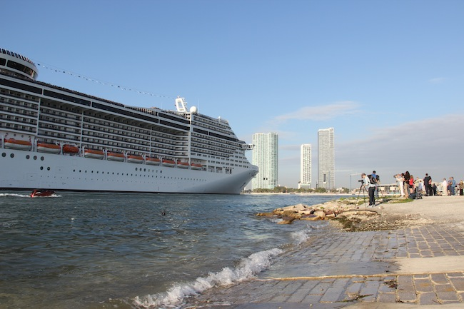 Clumps of photographers snapped away as MSC Divina sailed past before turning around to dock on the bank opposite