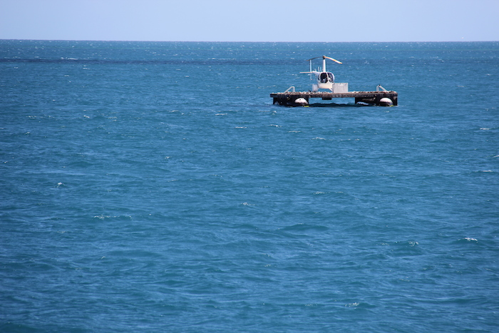 Hamilton Island Air Helicopter lands on a pontoon near ReefWorld on the Great Barrier Reef