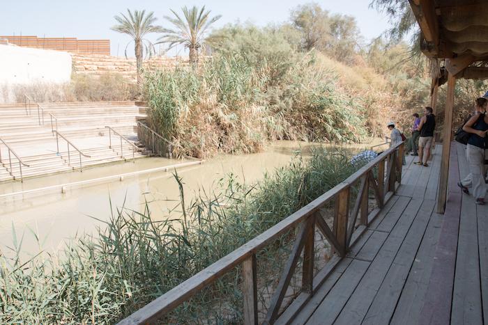 River Jordan at the The Baptism site of Jesus Christ showing both Jordan and West Bank / Israel sides