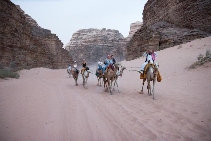 Tourists riding camels in Wadi Rum Desert Jordan