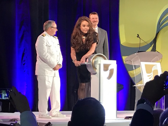 Sarah Brightman launches the champagne bottle at Seabourn Encore naming ceremony