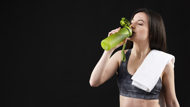 front-view-sporty-woman-drinking-water