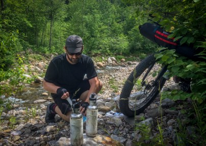 One very nice thing about bikepacking in the Moosalamoo region is that you are never far from water. So much so it was always the least of our concerns and we traveled rather light with only about three 20 oz water bottles at any given time. This was also nice as we were able to simply carry a Sawyer Mini for filtration, as shown here by Middlebury Creek.