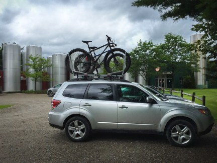My Subaru Forester exactly how she wants to be: stacked with two Surly bikes and parked in front of a microbrewery, which in this case was the Otter Creek Brewing Company in Middlebury, Vermont.