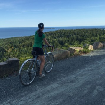 Nancy enjoying the stunning ocean views from the carriage road climb up Day Mountain