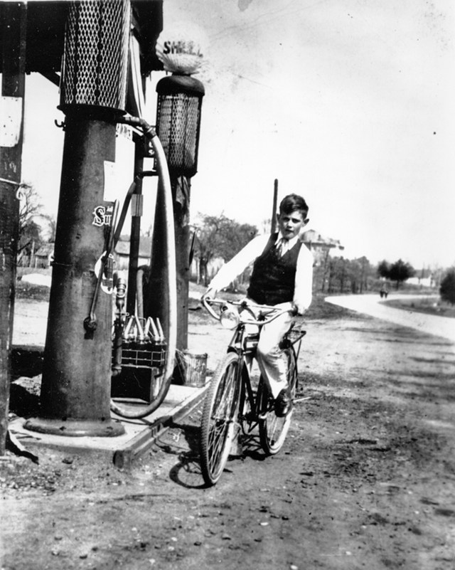Uncle Allen on his bicycle in front of Bozo's. (1925 Building)