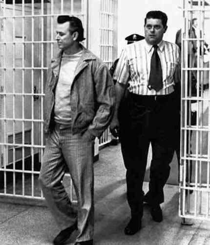 James Earl Ray being escorted into the Tennessee State Prison. After being convicted of the assassination of Martin Luther King, Ray spent time between TSP and Brushy Mountain, where he escaped twice, and he was brutally attacted on many occasions at both prisons.