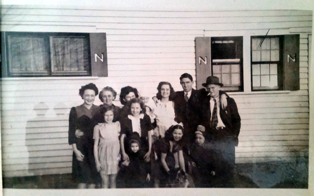 Dorthy, Grandmother, Ladye Frances, Aunt Helen, Uncle Richard, Grandfather, and Mom (There are some others...   Kids left to right: Mom, Betty Fern (friend), Glenda, Nannie holding Scrappy the dog, and David.    Ladye Frances is holding Marilyn)  Look at the shutters!