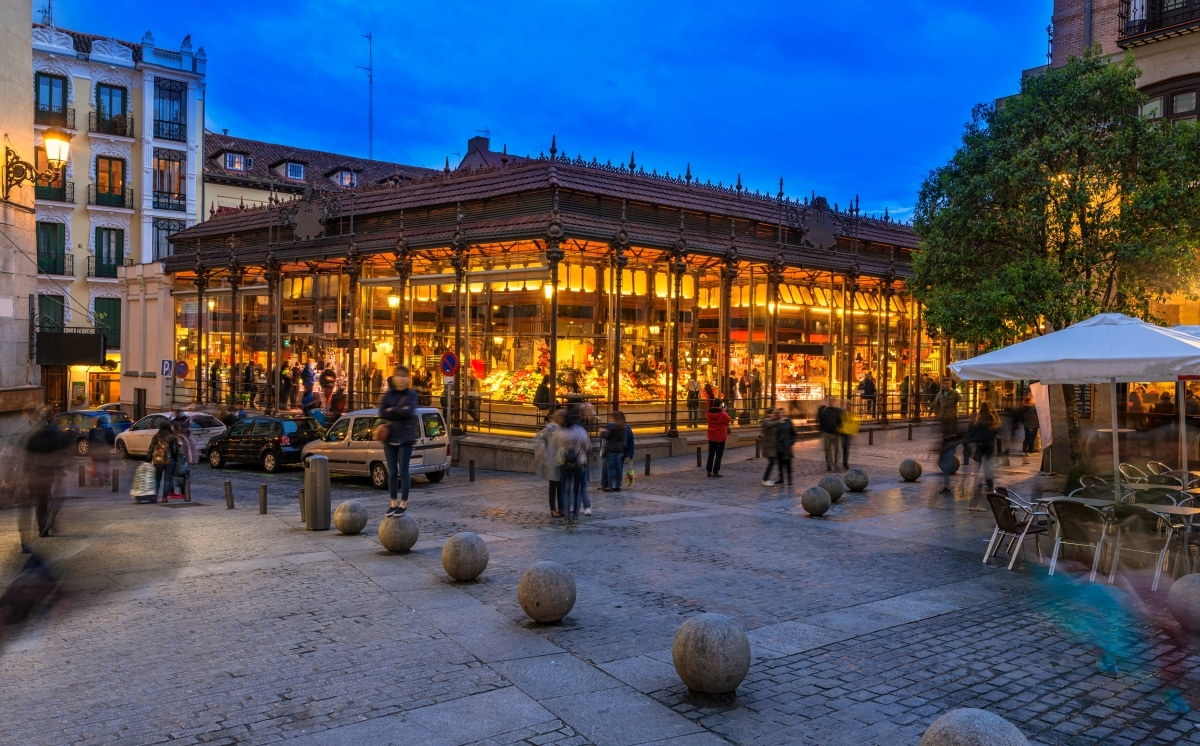 Night view of Mercado San Miguel in Madrid, Spain.