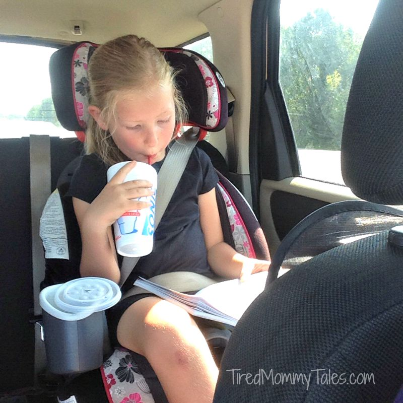 Reading in Car in Black Shirt
