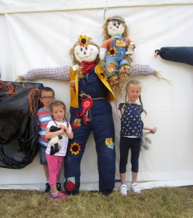 people and scarecrow