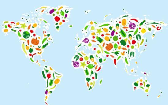 Imagen de un mapa mundi donde los países están rellenos de dibujos de verduras y frutas