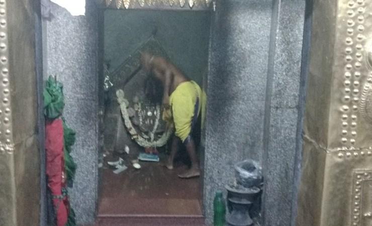 A Priest On Duty In Maldakal Temple
