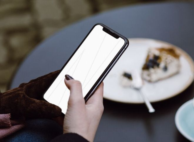 iPhone X Woman Cafe Mockup PSD