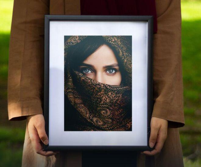 Woman Holding Photo Frame PSD Mockup