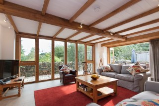 Large windows flood the lounge with natural light