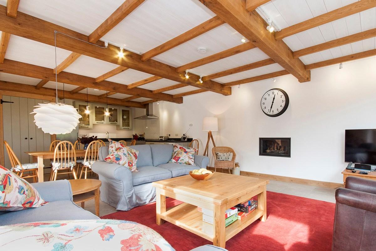 Tithe Barn Ashburton. Lounge towards kitchen.