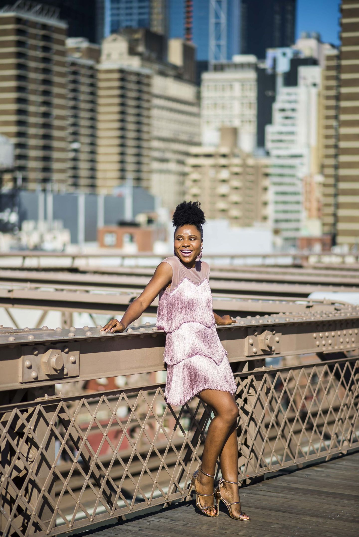woman in purple fringe dress on bridge