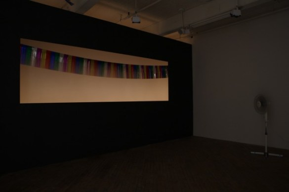 It Is What It Is..., 2009  Wall, holiday lights, mylar banner, fan, wind, and sound.