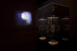 """Hush II, 2013, 24"""" x24'x 80"""" Acrylic mirrored, found birdcage, rice paper, pen and ink, with pedestal and Let me tell you a secret, 2009, dimensions variable, HD video 7 minutes, seven seconds looped. Photo credit: David Mielcarek"""