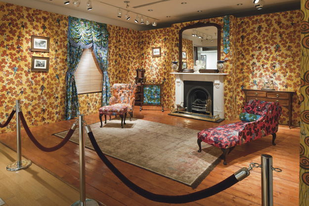 Yinka Shonibare MBE - Victorian Philanthropist's Parlour, 1996–1997. Dutch wax-printed fabric-covered wood, cast iron, brass, marble, mirror, bound printed books, porcelain, glass, framed works on paper, and props, 103 × 109 × 192 in.