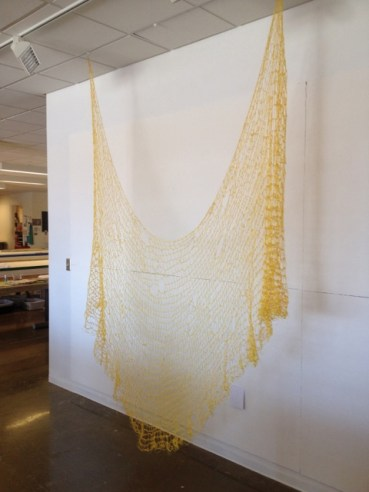 C. Pazia Mannella, Golden, 2014. Crocheted ribbon, dimensions variable.