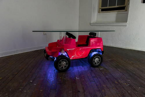 "Casey Poehlein, Untitled, 2015. Found toy car, led lights, PVC, glass, 23""x52""x24"""