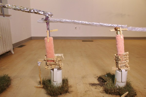 Aquaduct #3 (Basement Flooding Mechanism), May 2015, installation (turf, tin foil, paint rollers, Rolo's, clothes pins, bagels, spaghetti, water), dimensions variable.