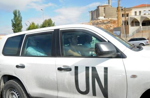 Un véhicule de l'ONU est perçue à la frontière libano-syrienne comme inspecteurs de l'ONU retournent en Syrie le 25 Septembre 2013.