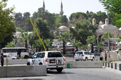 Un convoi de véhicules de l'ONU transportant des experts en armes chimiques à Damas le 29 Septembre 2013, pour enquêter sur l'utilisation présumée d'armes interdites.