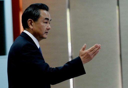 Le ministre chinois des Affaires étrangères Wang Yi, photographié en Juin, a salué dimanche l'accord entre les États-Unis et la Russie pour éliminer les armes chimiques de la Syrie