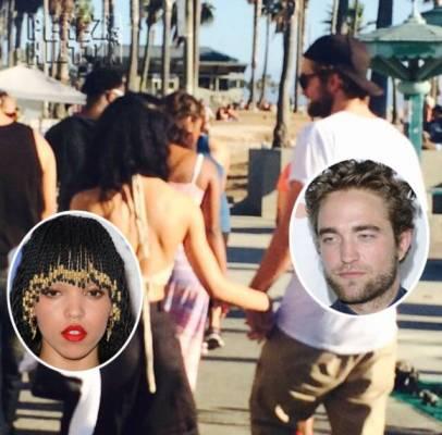 Le couple se balade main dans la main le long d'une plage californienne