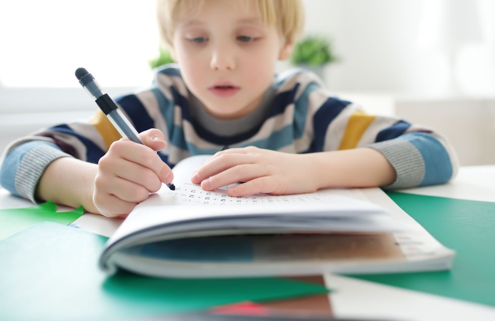 Image of child doing primary maths tuition online with TLC LIVE
