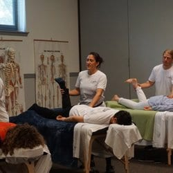 massage therapy students practicing body mobility techniques at The Lauterstein-Conway Massage School, Austin TX during their massage therapy program
