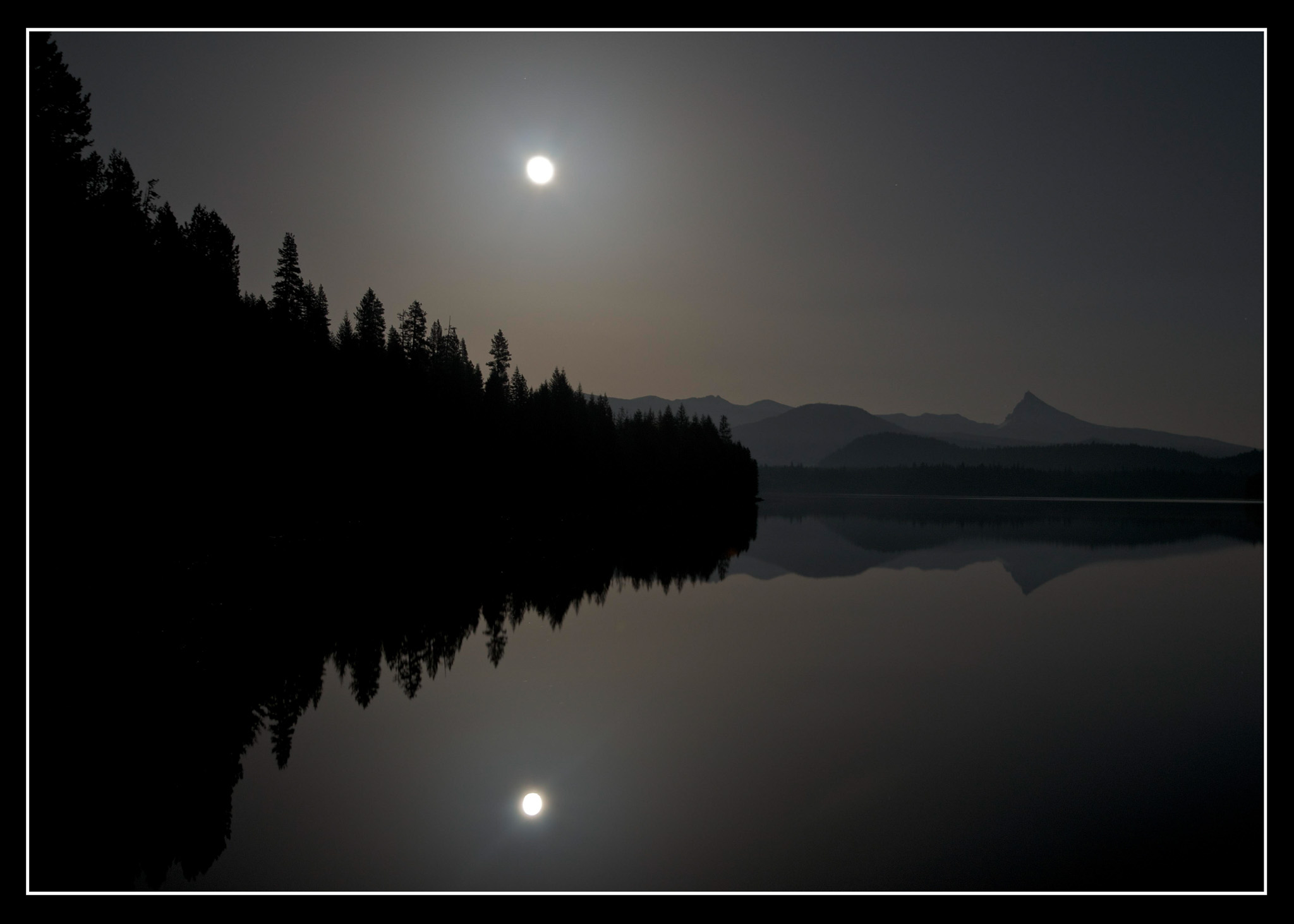 Moon glow over Lake Lemolo with Thielsen in the distance.