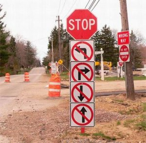 Signs: STOP, no right, no left, no back, no ahead, wrong way, do not enter