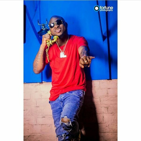 DMW Boss Davido  Appreciates A Lady Who Tattooed His Logo On Her Boobs