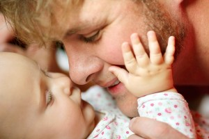 Happy Father Loving Newborn Baby Girl