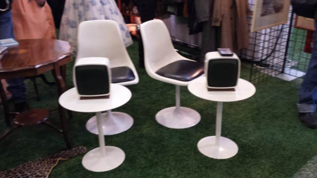 Seventies style white side tables and chairs.