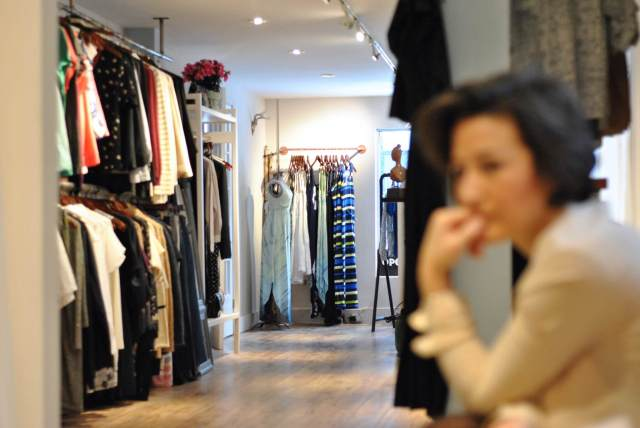 Photo looking into the store, showcasing some of the displays of clothing.