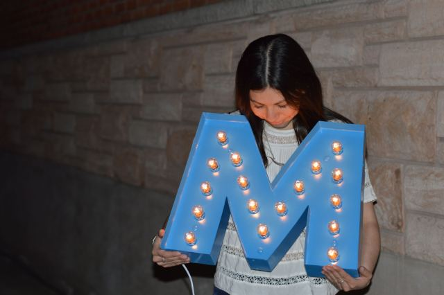"Looking down at the lit up ""M"" sign."