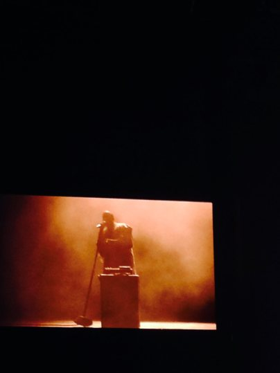 Kanye djs while on stage during one of his songs.