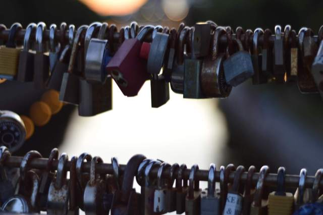 Close up of one of the railings on the bridge with many locks.