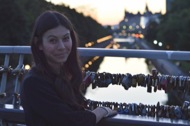 Photo of Meg overlooking the Rideau Canal from the Love Lock Bridge.