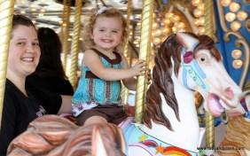 Lucy having fun on the carousel