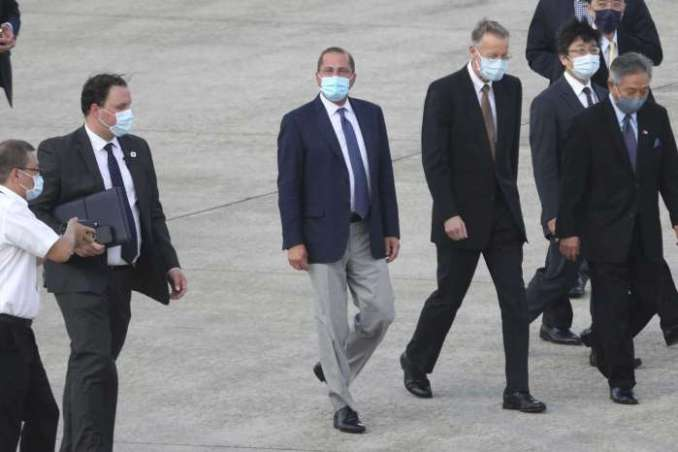 U.S. Health and Human Services Secretary Alex Azar, center, arrives at Taipei Songshan Airport in Taipei, Taiwan, Sunday, Aug. 9, 2020. Azar arrived in Taiwan on Sunday in the highest-level visit by an American Cabinet official since the break in formal diplomatic relations between Washington and Taipei in 1979.Chiang Ying-ying/AP