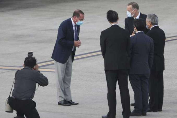 U.S. Health and Human Services Secretary Alex Azar, second left, greets Taiwanese officers as he arrives at Taipei Songshan Airport in Taipei, Taiwan, Sunday, Aug. 9, 2020. Azar arrived in Taiwan on Sunday in the highest-level visit by an American Cabinet official since the break in formal diplomatic relations between Washington and Taipei in 1979.Chiang Ying-ying/AP
