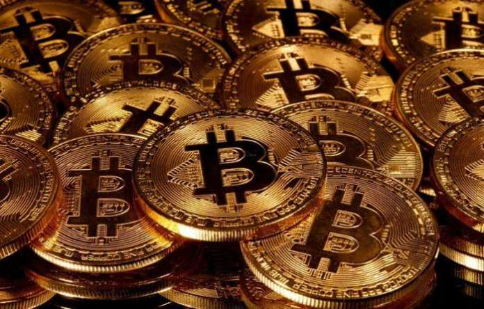 FILE PHOTO - Representations of virtual currency bitcoin are seen in this picture illustration taken taken March 13, 2020. REUTERS-Dado Ruvic-Illustration