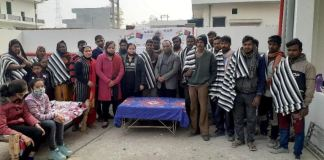 Human Legal Aid and Crime Control Society, an example of human service, distributed blankets to 150 needy people to protect them from the cold