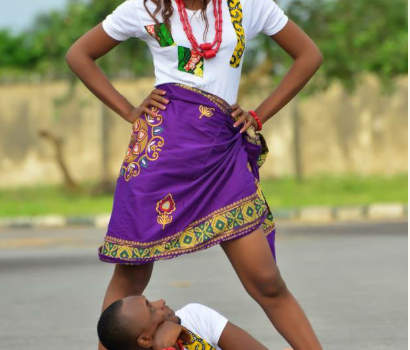 Man Stares under fiancees legs for pre-wedding shoot